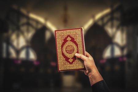 Koran in hand - holy book of Muslims( public item of all muslims )Koran in hand muslims .
