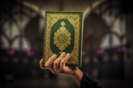 Koran in hand - holy book of Muslims( public item of all muslims )Koran in hand muslims
