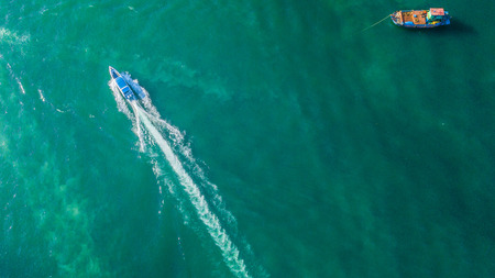 Aerial view of speed boat in the sea .