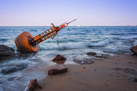 Navigation buoy Aground on the beach . Stock Photo