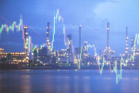 Oil refinery with candlestick graph background , Business and financial concept