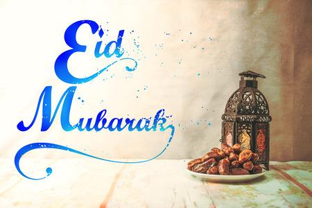 eid mubarak with date palm fruit or kurma , ramadan food , image Vintage style . Stock Photo