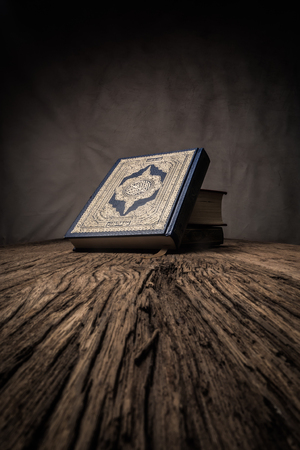 Koran - holy book of Muslims ( public item of all muslims ) on the table , still life  . Imagens