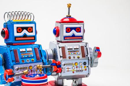 robot tin toy on white background . . Stock Photo