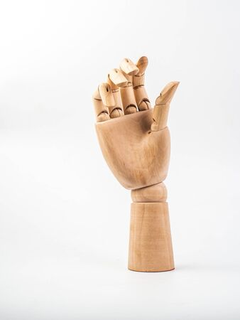 hand of wood doll on white bakground . Stockfoto