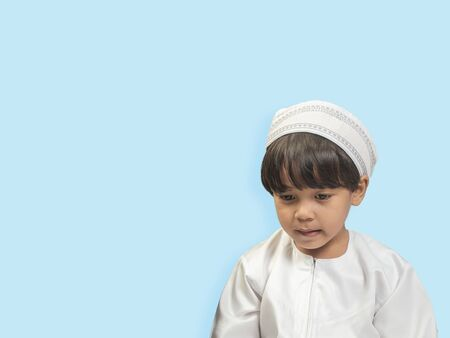 Muslim boy in a dress , isolate background  .
