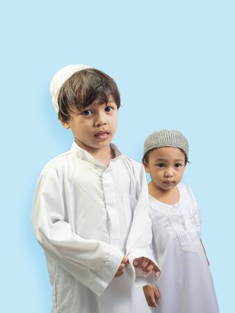 Muslim boy in a dress , isolate background Stock Photo