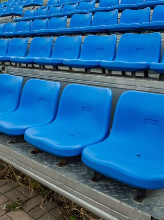 Blue chair on the grandstand .