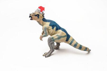 Pachycephalosaurus Dinosaur with Christmas hat on white background . Reklamní fotografie