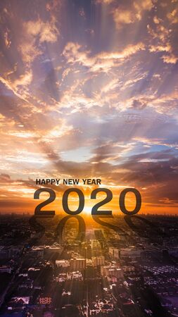 Happy new year 2020 two thousand twenty with sunset in the morning .
