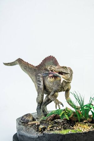 Spinosaurus with Its food ,dinosaur on white background