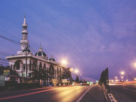 The mosque in the morning and evening car lights, lights trails long exposure . 에디토리얼