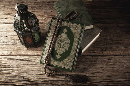 Koran - holy book of Muslims ( public item of all muslims ) on the table , still life .