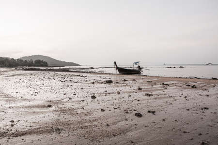 small fishing boat on the beach in the evening 版權商用圖片