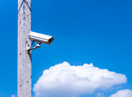 electronic survey: closed circuit camera with blue sky and cloud Stock Photo