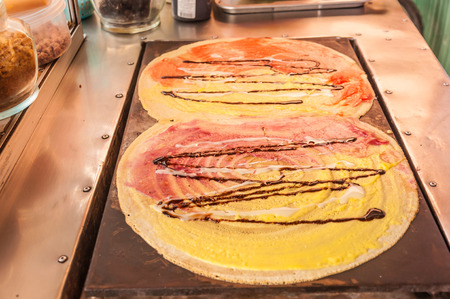 Crepes Japan with cream,blueberry,Strawberry and chocolate on the stove
