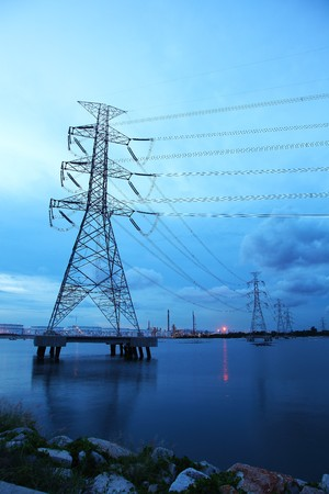 Electrical Tower on Sea Pass Through Petrochemical Industrial Estate photo