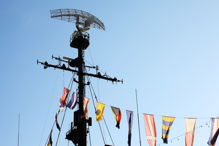 radar gun: Radar system and communication tower on a navy patrol frigate