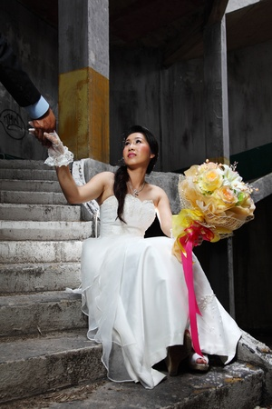 Bride Holding Groom photo