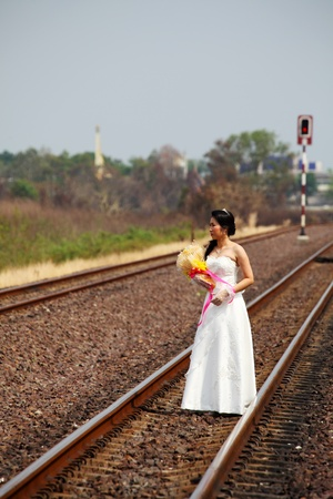 Beautiful Young Bride on A Railway Road photo