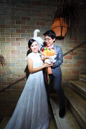 Beautiful wedding couple with bouquet in castle photo