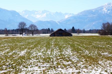 An image of firewood house in Bavaria Germany covered in snow Zdjęcie Seryjne - 22011237