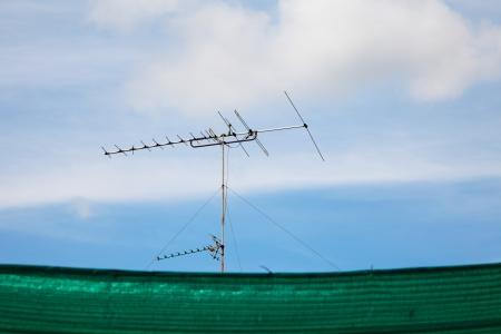 old television antenna against blue sky  Zdjęcie Seryjne