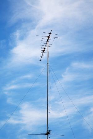 old television antenna against blue sky Zdjęcie Seryjne - 22544053