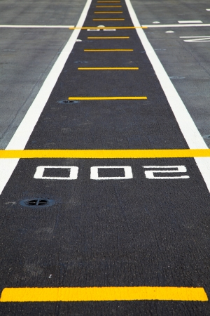 Small runway on the deck of aircraft carrier photo