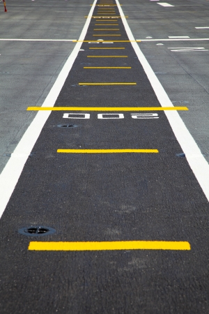 Small runway on the deck of aircraft carrier Zdjęcie Seryjne - 24089708