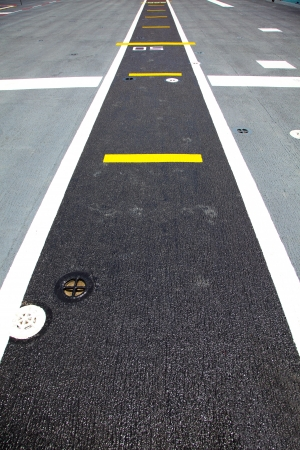 Small runway on the deck of aircraft carrier Zdjęcie Seryjne - 24682359