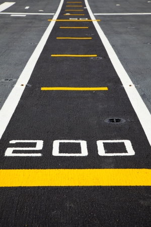 Small runway on the deck of aircraft carrier Zdjęcie Seryjne - 24682360