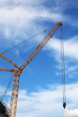 The Building Crane on Blue Sky