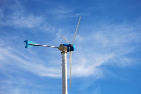 Wind Energy Turbine on Blue Sky Background