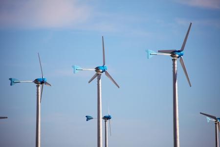 Green renewable energy concept - wind generator turbines in sky Zdjęcie Seryjne - 24733479