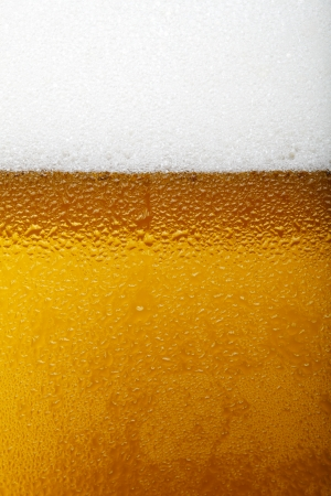 Close-up picture of a beer with foam and bubbles Zdjęcie Seryjne
