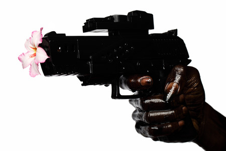 Flower And Gun Held By Hand Stained With Engine Oil Zdjęcie Seryjne - 25510330