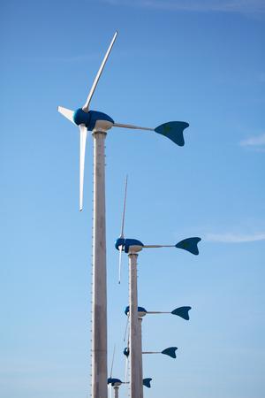 Green renewable energy concept - wind generator turbines on blue sky background Zdjęcie Seryjne - 36107168