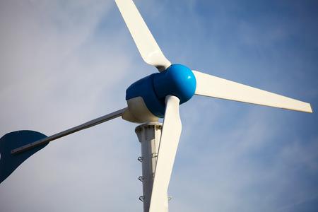 Green renewable energy concept - wind generator turbines on blue sky background Zdjęcie Seryjne - 36107173