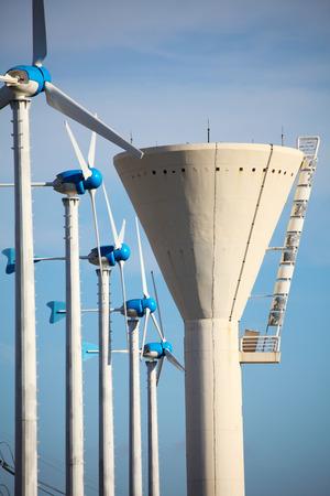 Green renewable energy concept - wind generator turbines and tower Zdjęcie Seryjne