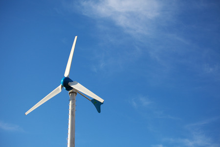 Green renewable energy concept - wind generator turbines on blue sky background Zdjęcie Seryjne - 36297834