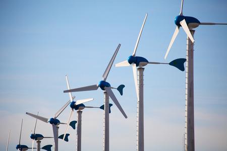 Green renewable energy concept - wind generator turbines on blue sky background Zdjęcie Seryjne - 36298152