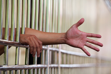 carcel: Mano en la cárcel
