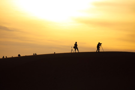 hummock: Photo of Sand Dunes with Travellers, Mui Ne, Vietnam