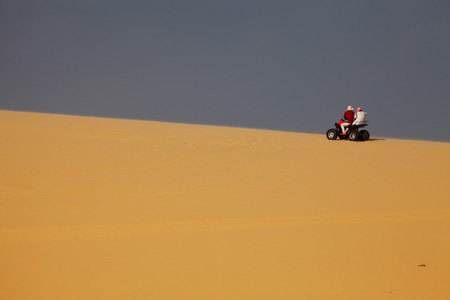 A Couple Riding Quad Bike in Desert, Mui Ne