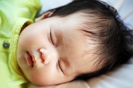 peacefully: Newborn Baby Peacefully Sleeping