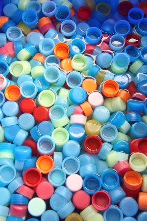 ows: In many colors bottle caps with caps in four colors. Stock Photo