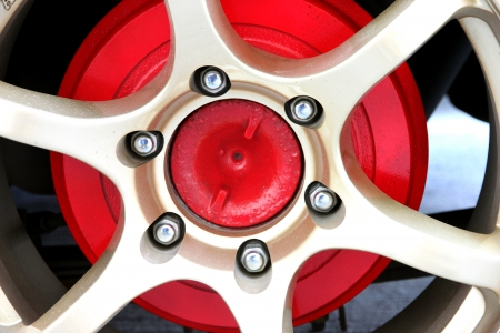The Gold Alloy Wheel and Red Background