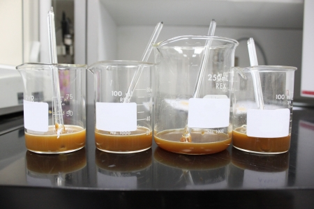 Four Experimental bottles,have a Laboratory reagents in bottles. photo