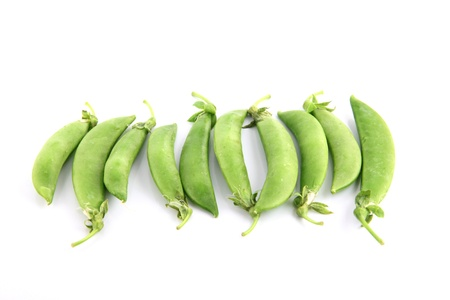 The Green peas on a white background. photo